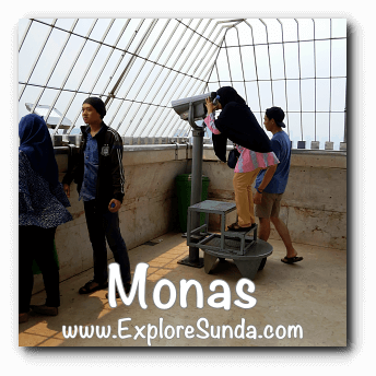 Use telescope to see far away objects in the observation deck of Monas, Jakarta