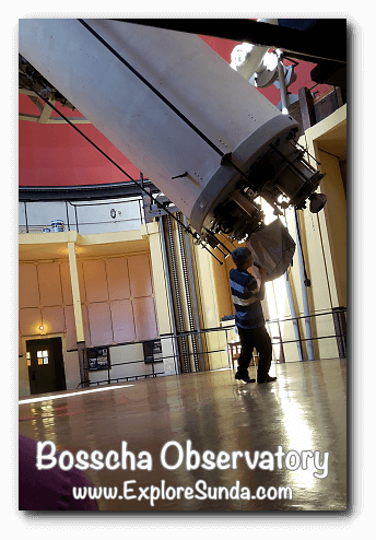 The scientist must manually pull or push to adjust the angle of the 1928 Zeiss Telescope in Bosscha Observatory, Lembang.