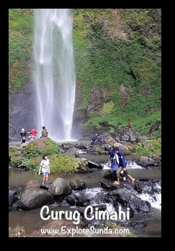 People play water at the pool of Curug Cimahi, the Rainbow Waterfall, at Cisarua Lembang.
