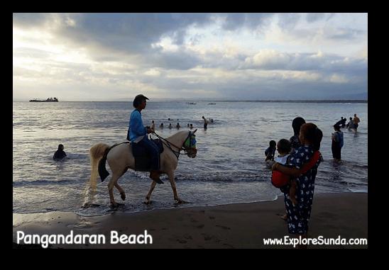 Riding a horse at Pangandaran beach